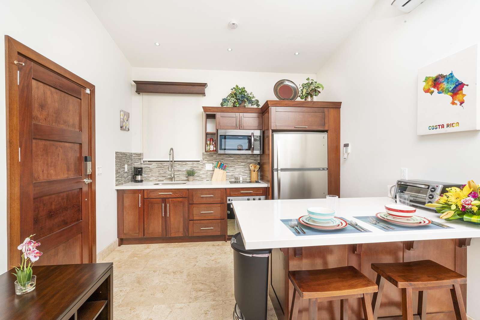 View of gourmet kitchen, breakfast bar, main entry