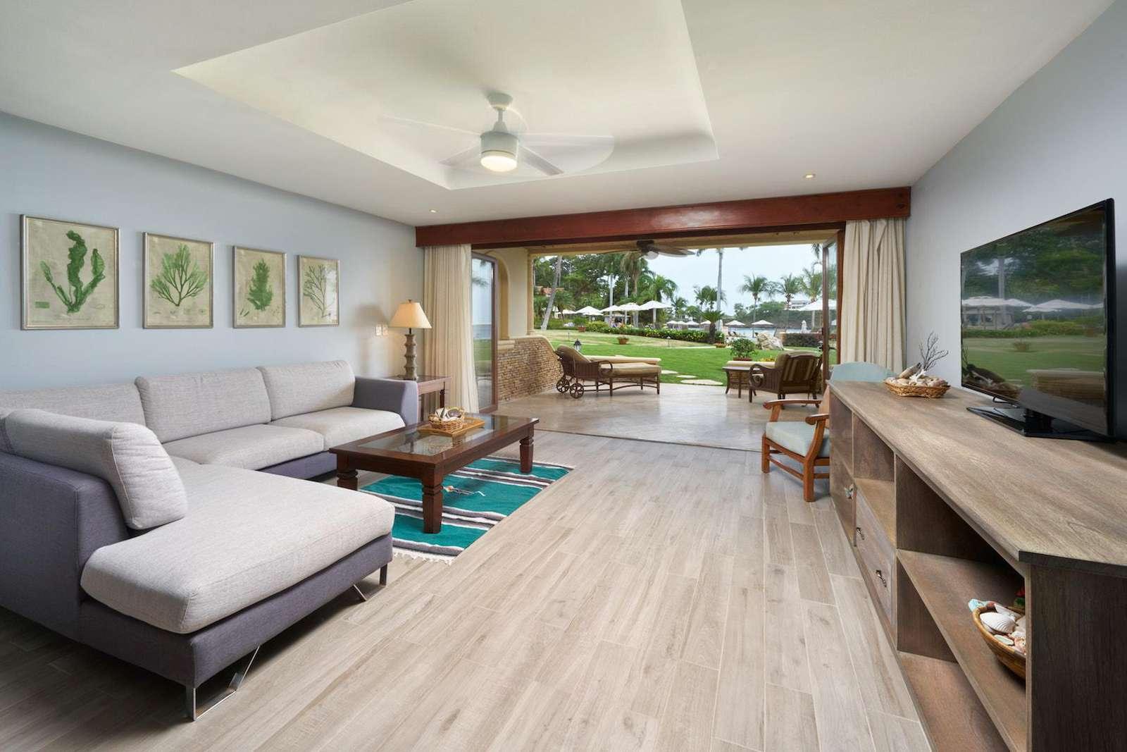 Living area looking towards ocean and pool