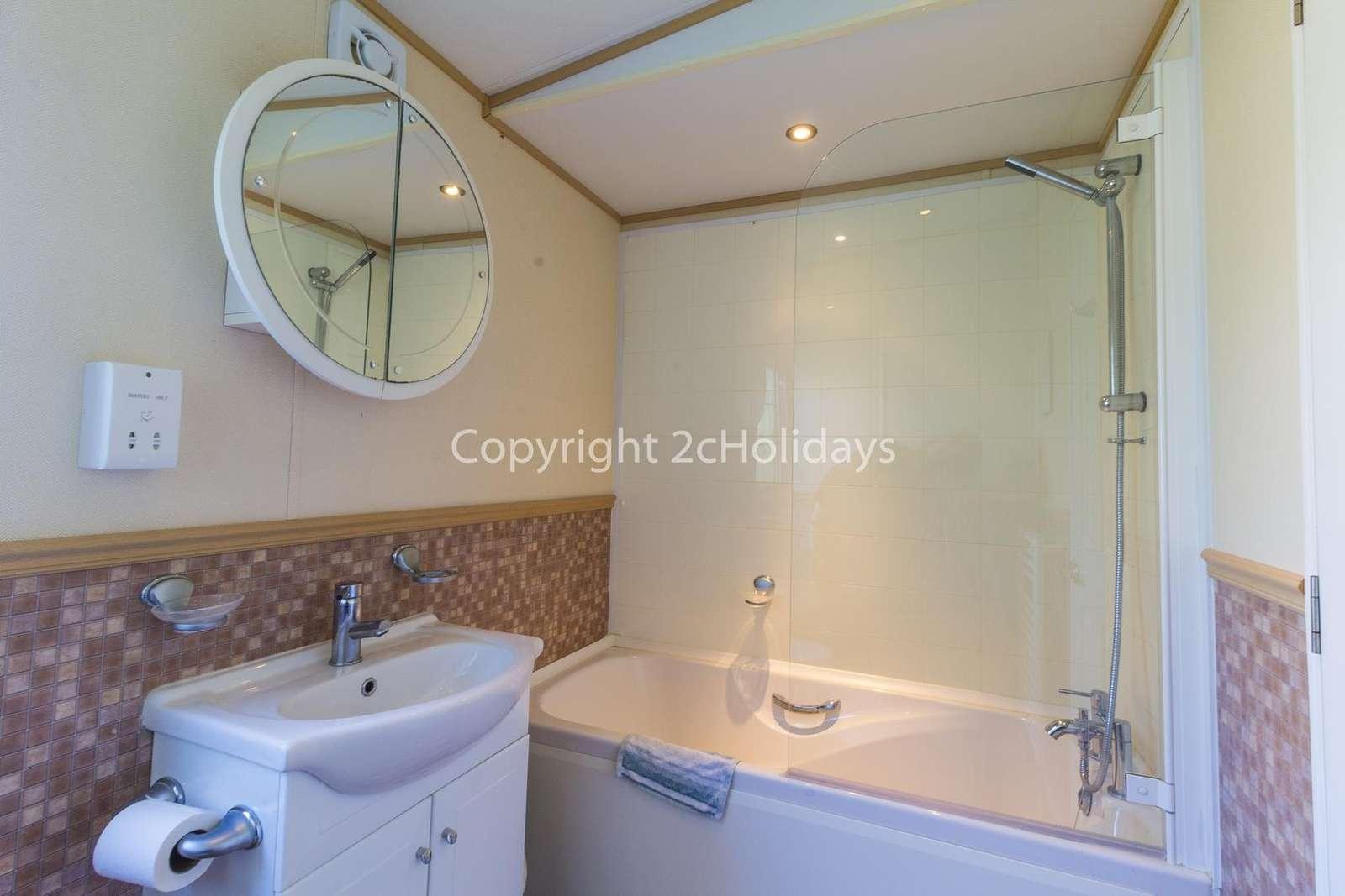 Family bathroom with a bath!