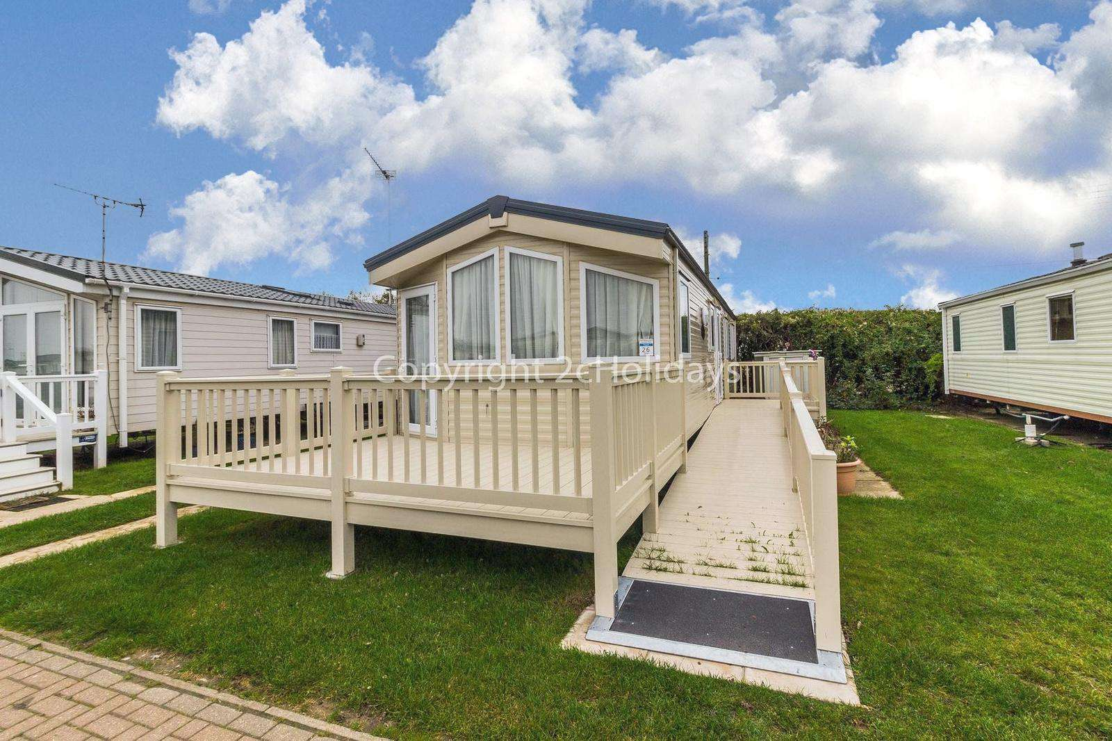 8 berth accommodation with decking at California Cliffs Holiday Park