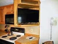 Flatscreen TV with DISH Network in ML229 living area. thumb