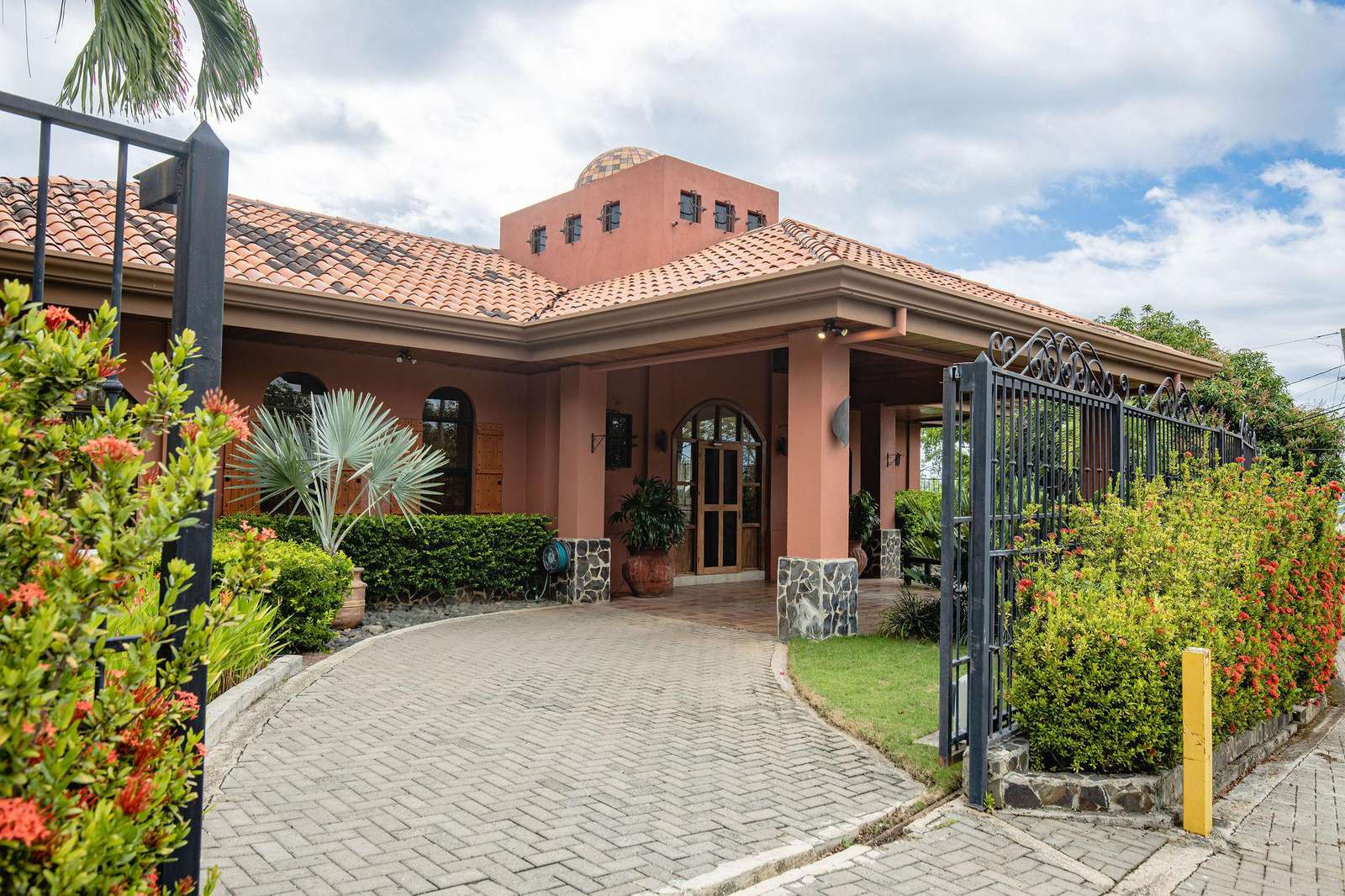 Casa Rosa, exterior, main gated entry view