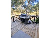 Weber 4-Burner Gas Grill (w/ Propane Provided) thumb