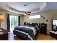 Master bedroom with access to the pool thumb