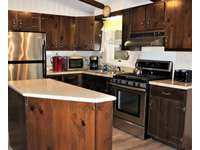 Another View of Kitchen Island, Stove, Refrigerator and Counters thumb