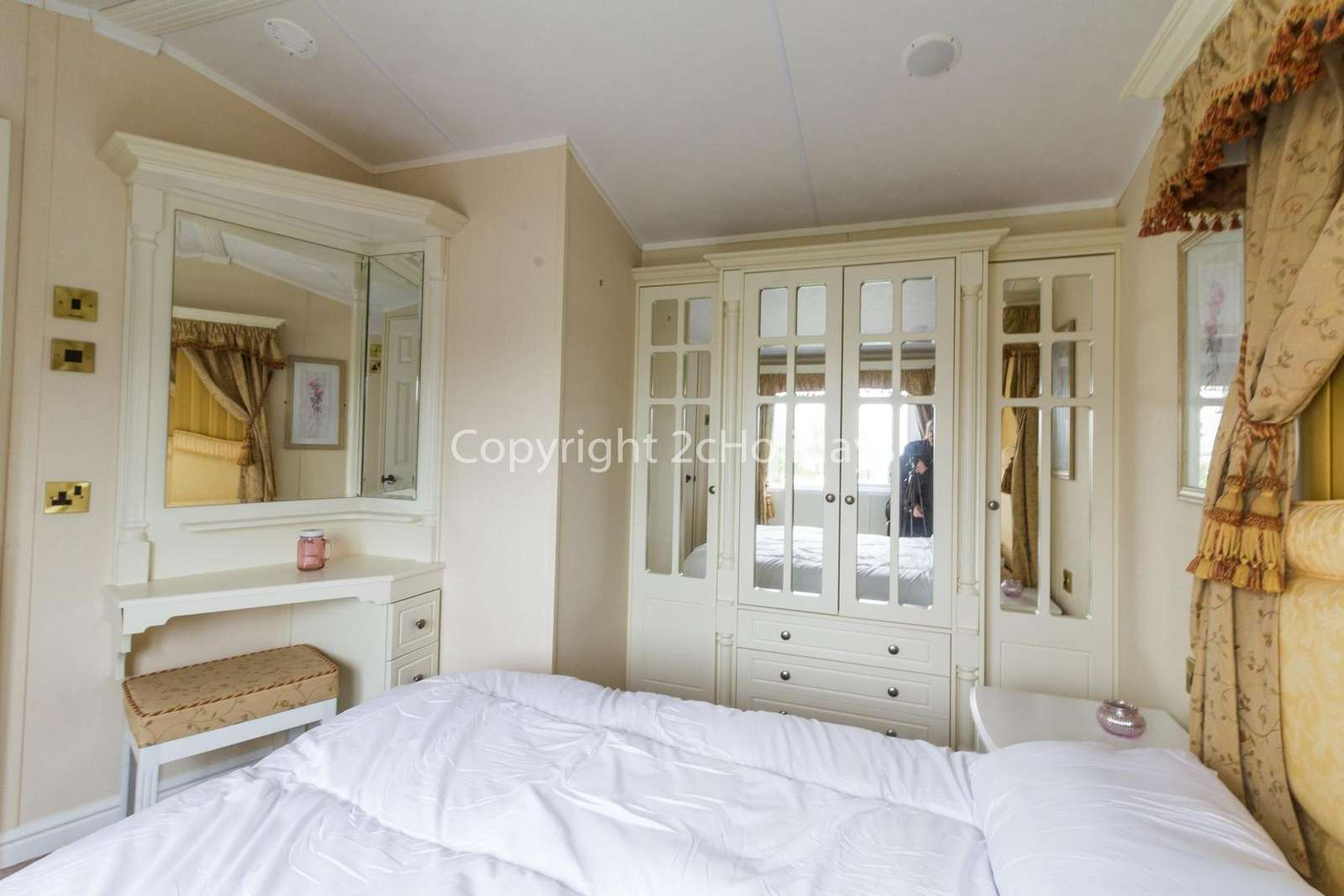 You can find plenty fo storage space in this master bedroom!