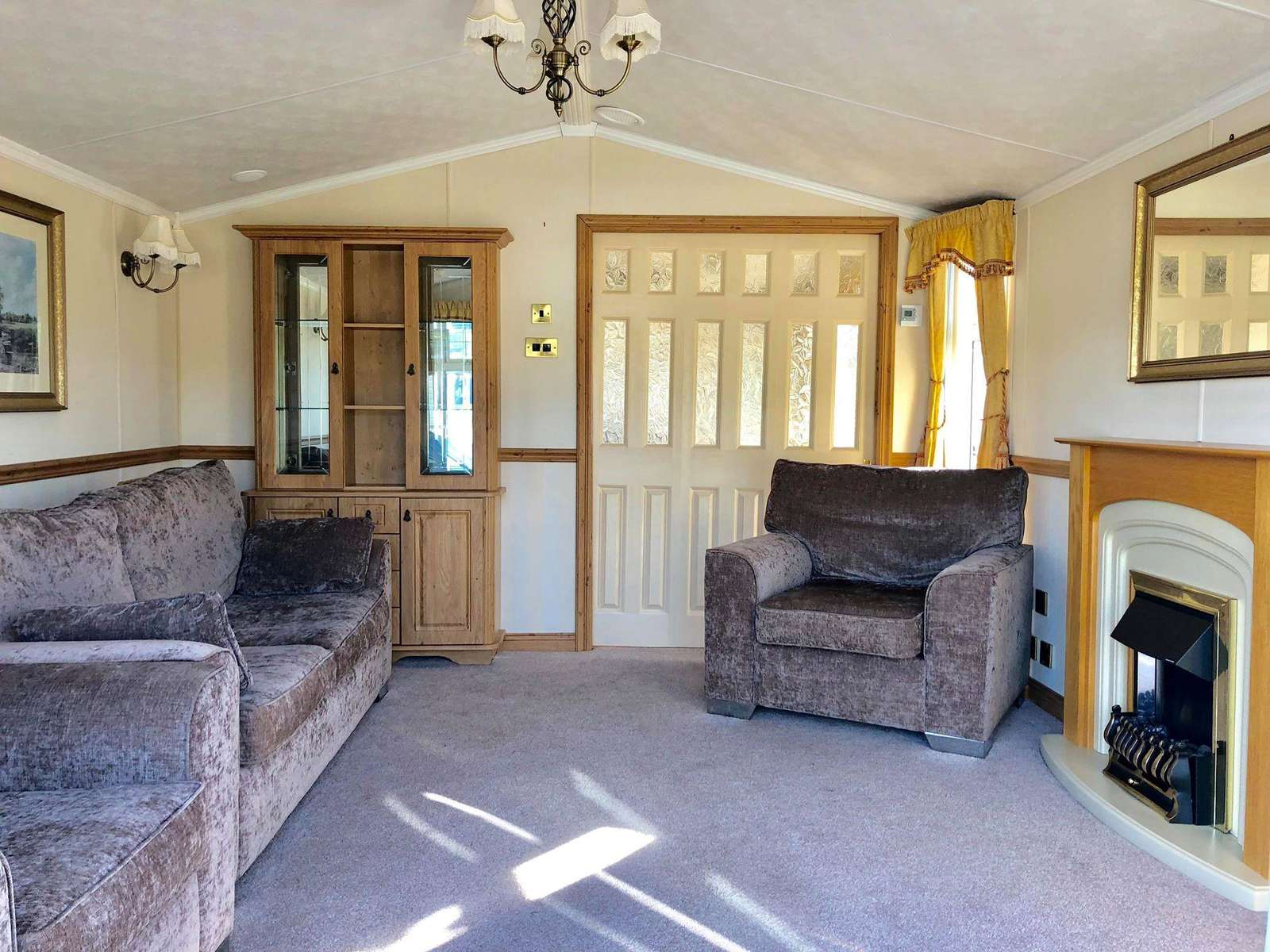 A very homely lounge with an electric fire and smart TV with complimentary wifi!