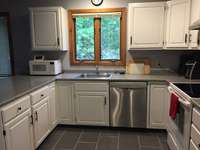 kitchen - Renovated kitchen cabinets, new tile floor, counter, appliances thumb