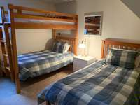 3rd bedroom - bunks and a twin thumb