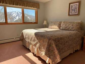 Private top floor master with stunning views of Mount Snow.  Also has a ceiling fan for summer comfort. thumb
