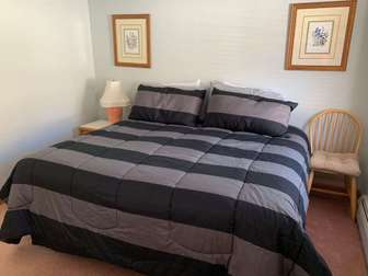 main floor bedroom with queen bed thumb