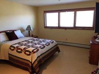 Lower floor Queen bedroom thumb