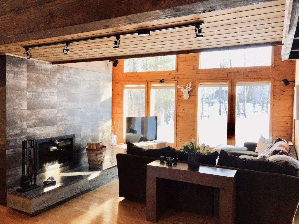 Step into sunlight, wood beams, and an inviting family room with dramatic fireplace. - property