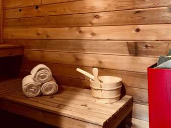 A warm sauna invites you home after a day on the slopes. thumb