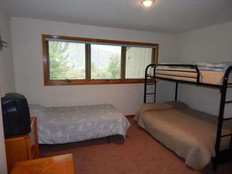 Lower floor bedroom #2 sleeps four, with one twin, one upper twin bunk, and one lower full size bunk. thumb