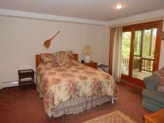 Lower floor bedroom shot #2 with queen bed and deck! thumb