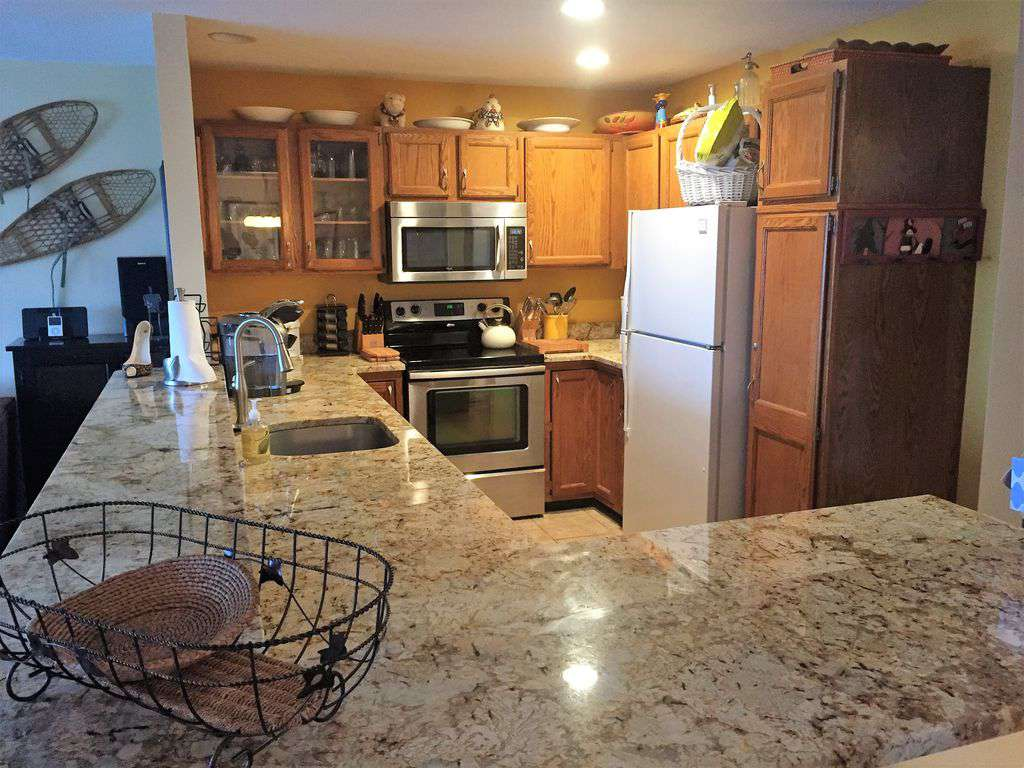 Gleaming granite counters - property