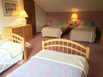 4 twin beds in 3rd bedroom upstairs -- perfect for all the kids thumb