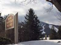 Welcome to Snow Mountain Village in front of Mount Snow thumb