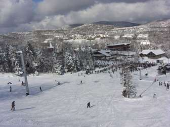 Snow Mountain Village seen from the slopes thumb