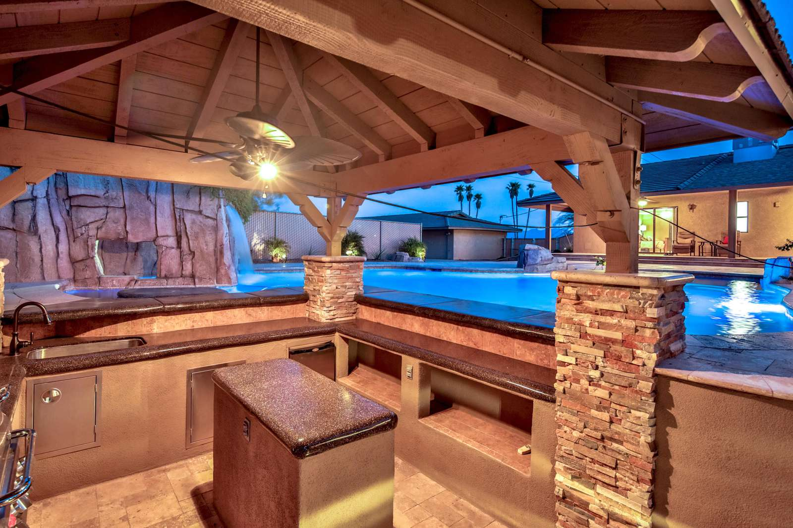 Stay Cool while cooking surrounded by misters and the pool