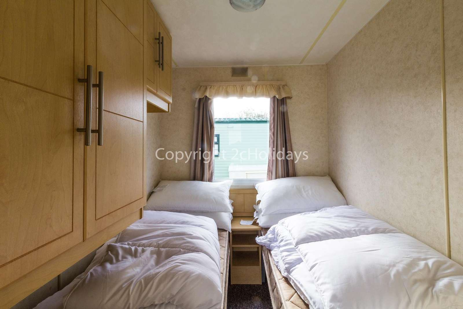 Cosy and comfortable twin bedroom with plenty of storage