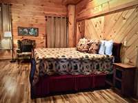 King Suite offers a third Flat Screen TV, access to the Hot Tub Deck, Fire Pit, Media Room thumb