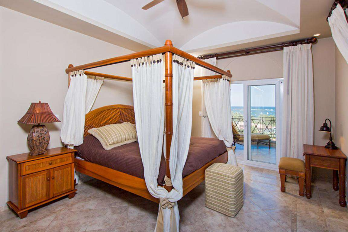 Master bedroom, king size canopy bed, incredible ocean views