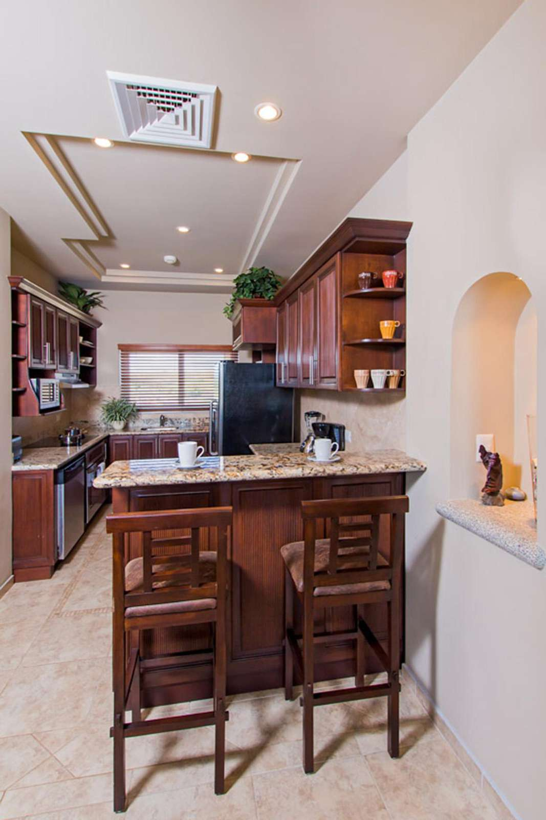 Another view of the kitchen and breakfast bar