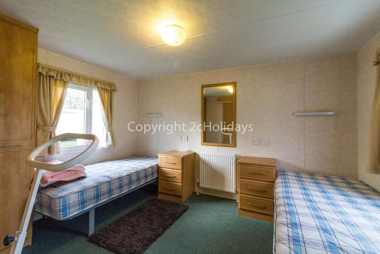 Very spacious twin bedroom with two single beds