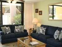 Living Room w/New Sofa, Love Seat and Rug thumb