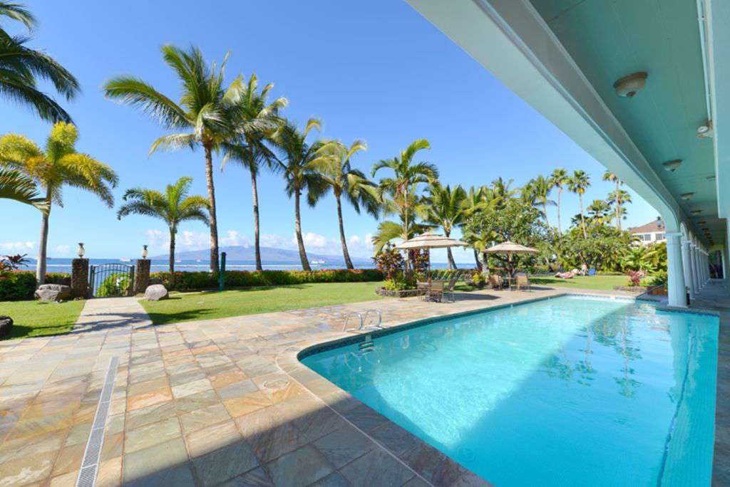 Oceanfront Pool Area with Jacuzzi - property