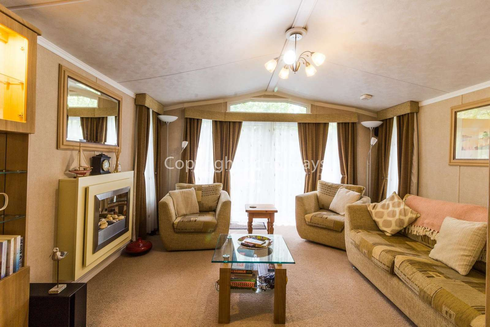 A homely and cosy living area with a TV and DVD player