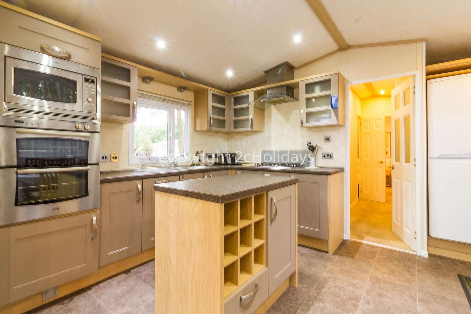 This kitchen includes a double oven and a full size fridge/freezer!