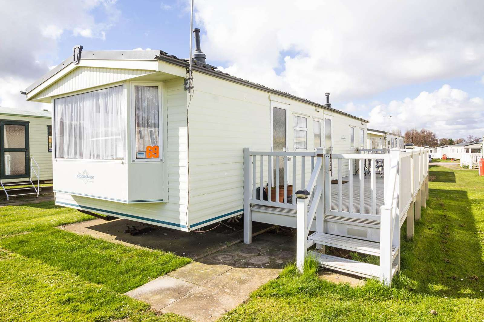 23069C – Chelsea area, 3 bed, 8 berth caravan with decking. Emerald rated. - property