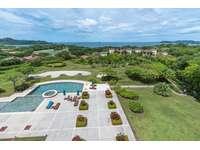 Spacious resort pool and ocean views thumb