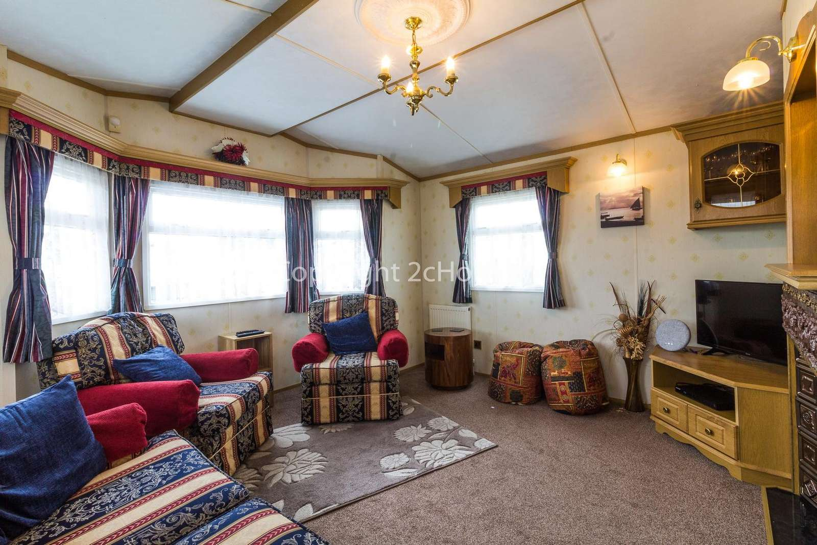 Cosy lounge area with a TV and electric fire!