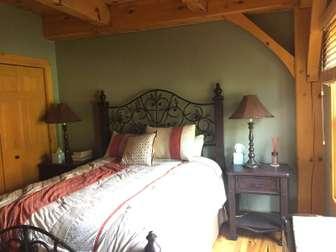Main floor bedroom - queen bed thumb