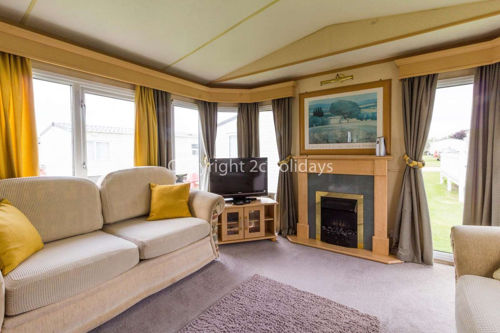 You can relax in this living area which comes with a TV and a gas fire