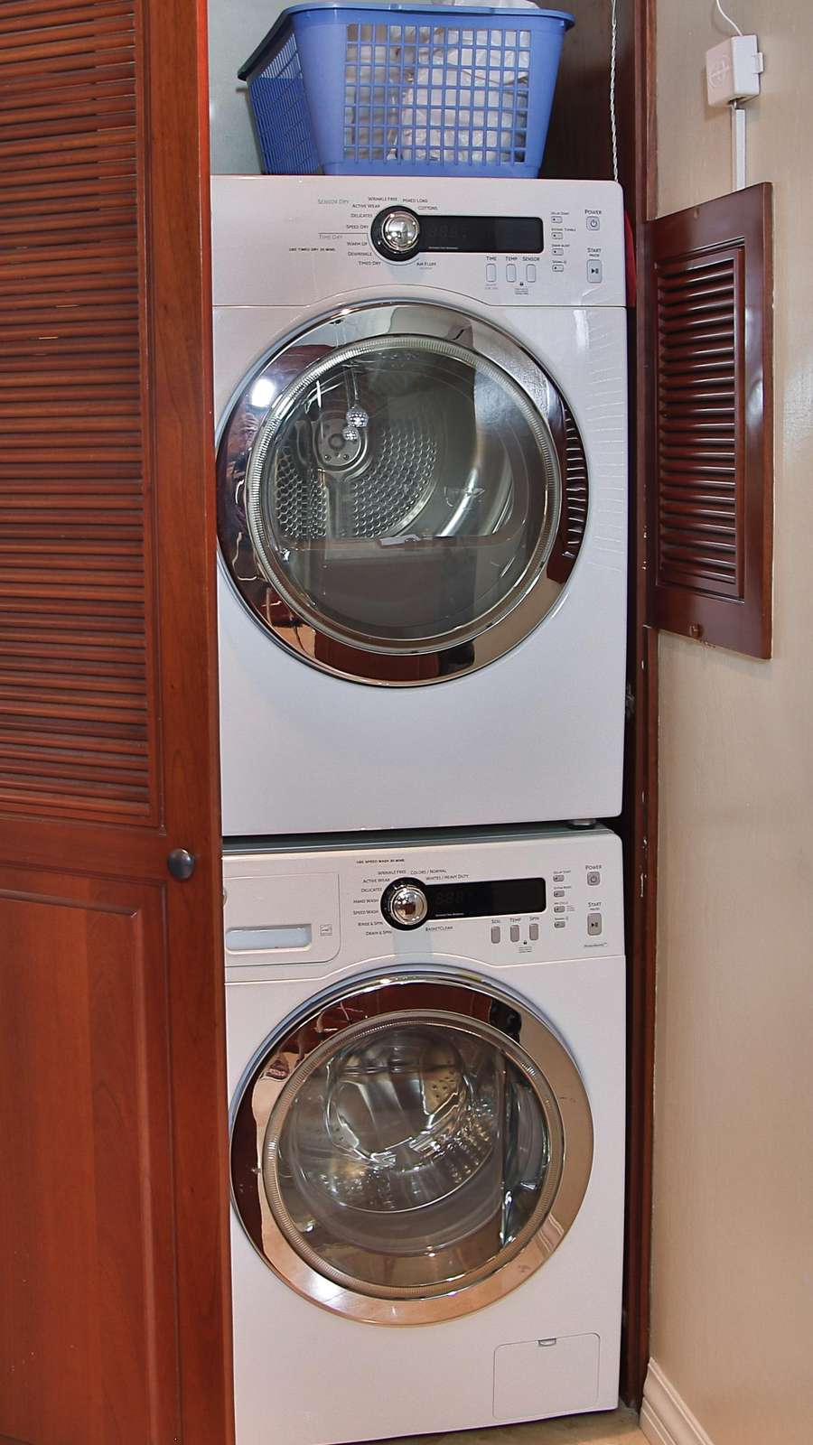 Private laundry room, front loading washer and dryer
