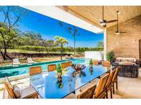 Outdoor dining area, pool and backyard thumb