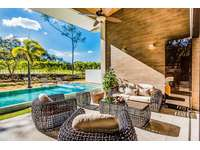 Outdoor lounge area and private pool thumb