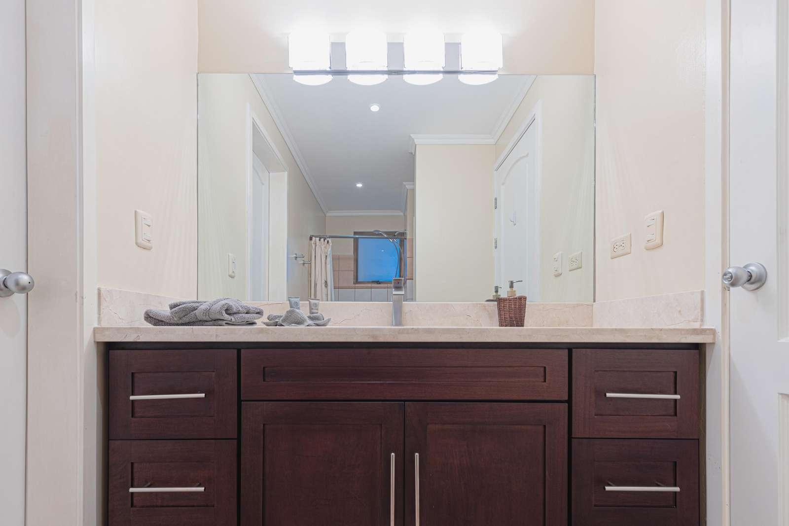 Master bathroom, granite countertops, wood cabinetry