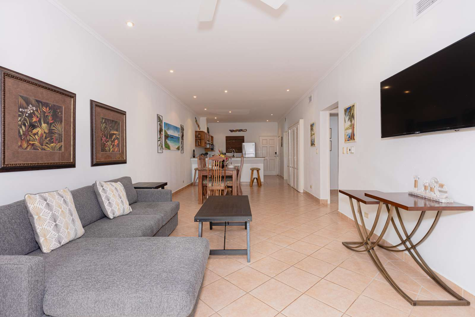 View of living area, smart TV, access to dining and kitchen