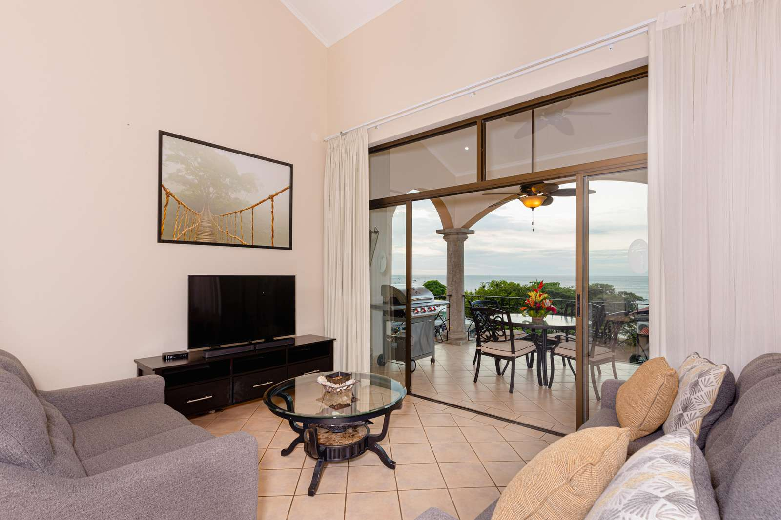 Spacious living area, ocean views and access to private balcony