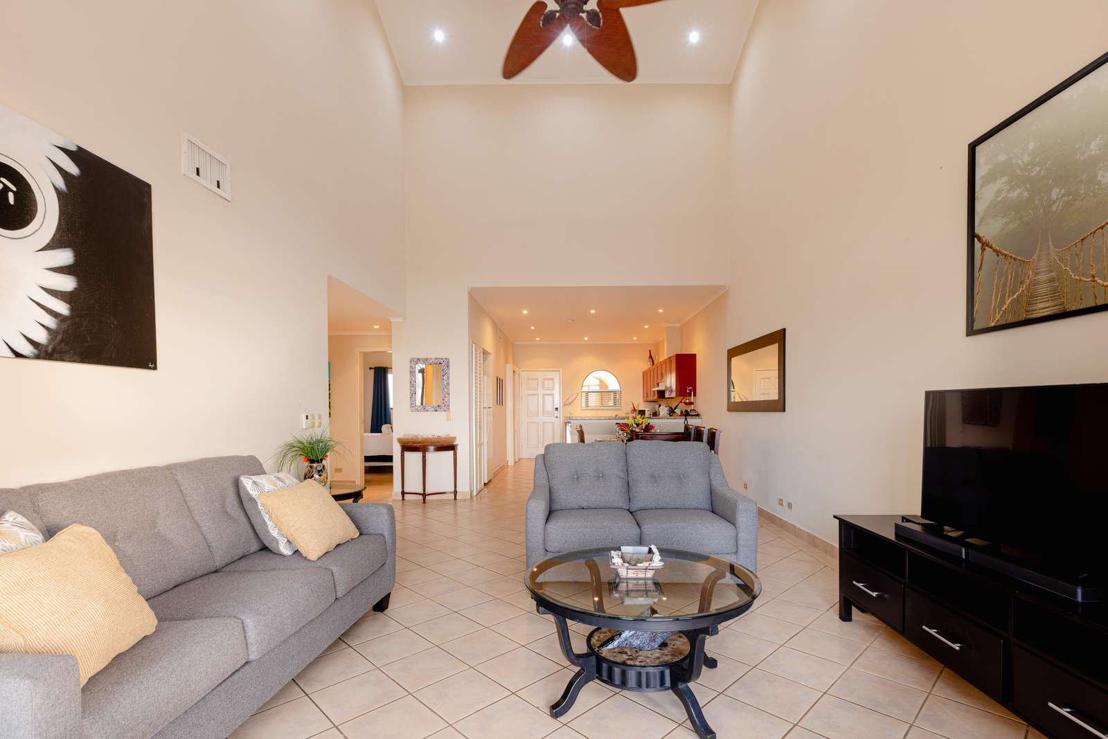 Spacious living area, view towards kitchen and dining area