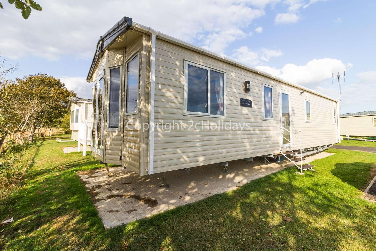 Luxury mobile home with a modern design throughout!