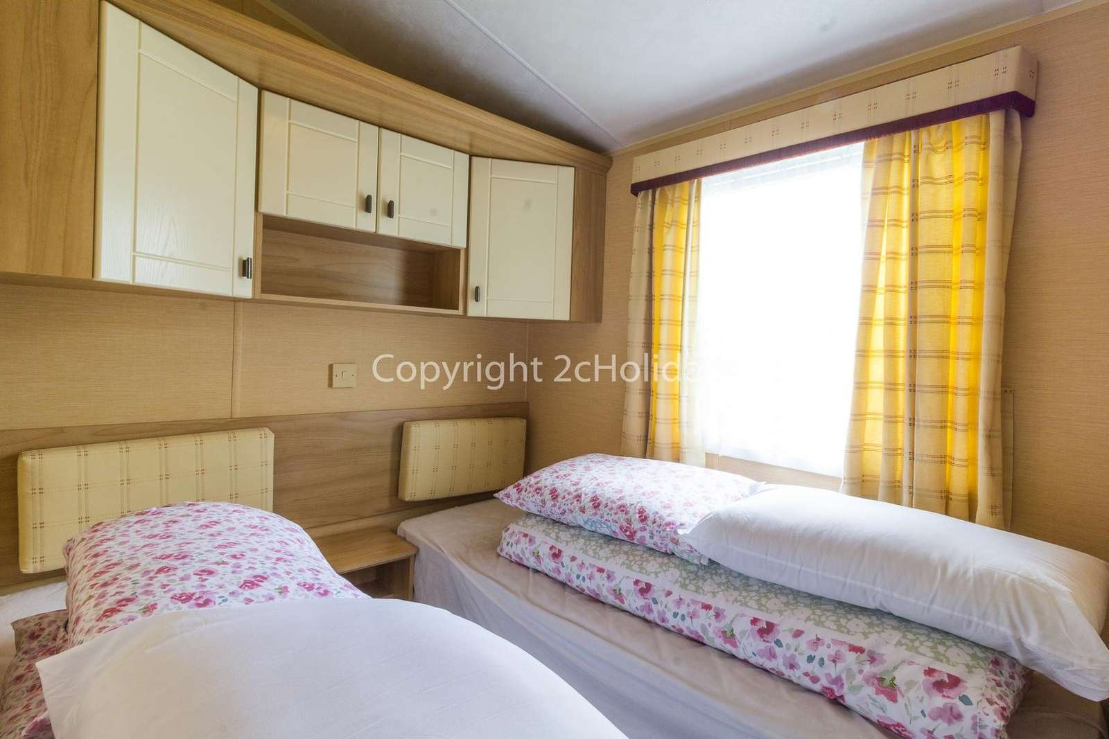 Plenty of storage in these modern twin bedrooms!