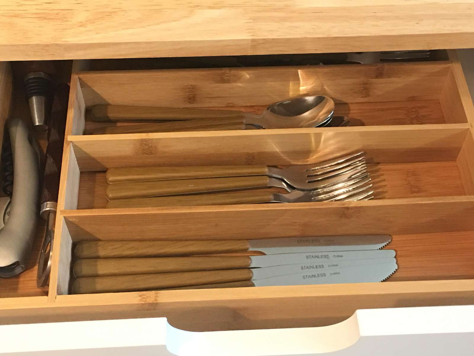 Corkscrew and cutlery drawer provides everything you need.