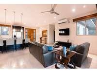 Spacious living area , Smart TV thumb
